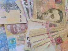 Одной из причин падения курса гривны является увеличение доходов населения, заявили в Нацбанке