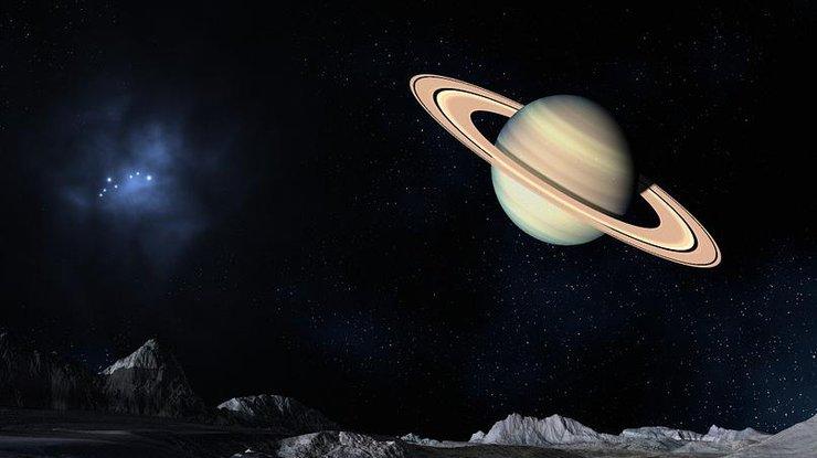 Под поверхностью спутника Сатурна нашли океан - ученые