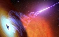Нейтронная звезда, вращающаяся вокруг черной дыры, может являться источником быстрых радиоимпульсов