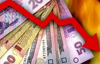 Курс гривні на міжбанку в п'ятницю знизився до 26,27 грн/$1
