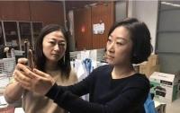 На одно лицо: iPhoneX не смог отличить двух китаянок