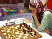 На чемпионате мира по классическим шахматам в Иране Музычук, как и остальные шахматистки, играла в головном платке