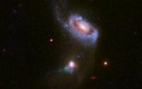 Хаббл сделал снимок поглощения галактики черной дырой