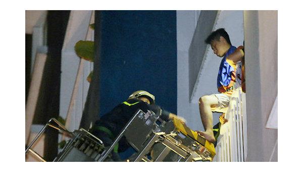 Спасаясь прыгали из окон. Пожар в жилом доме во Вьетнаме убил 13 человек