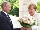 Меркель и Путин на встрече в Германии обсудят Украину и Сирию, а также реализацию крупных совместных проектов, - Песков